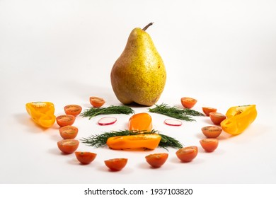 The face of a man made of sliced vegetables and a pear on his head on a white background.