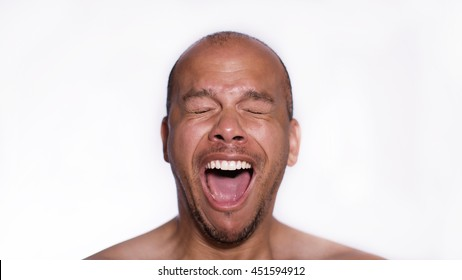 Face of a man yawning with his mouth wide open