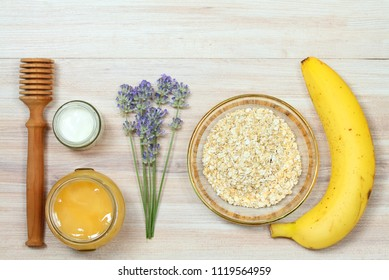 Face mask from oatmeal, yogurt, banana  and honey. Ingredients for homemade facial mask decoreted with lavender, flat lay
