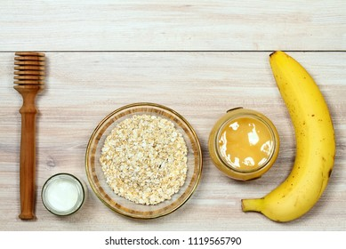 Face mask from oatmeal, yogurt, banana  and honey. Ingredients for homemade facial mask decoreted with lavander, flat lay