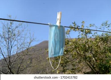 Face mask on the clothesline - Corona crisis