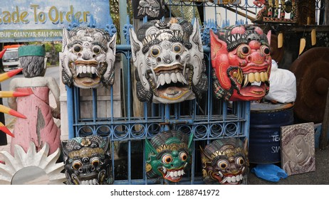 Face mask souvenirs, Hindu and Buddhist wooden carving. souvenir shop selling souvenirs and handicrafts of Bali at famous Ubud Market, Indonesia