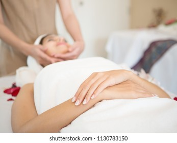 Face Massage. Close-up of a Woman Getting Spa face Treatment.