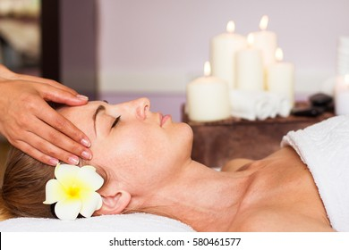 Face Massage. Close-up of a Young beautiful Woman Getting Spa Treatment.