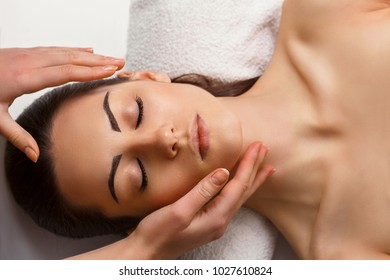 Face Massage. Close-up of a Young Female Getting Spa Treatment.