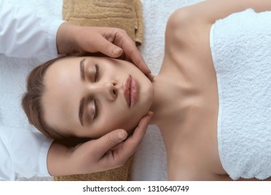 face massage woman with eyes closed