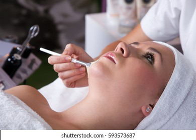 Face massage.Close up of hands massaging a beautiful woman's forehead at beauty spa