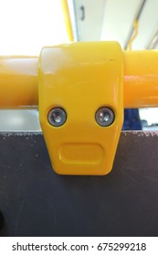 A face in a metal fitting on a bus, that looks like the Scream by Edvard Munch