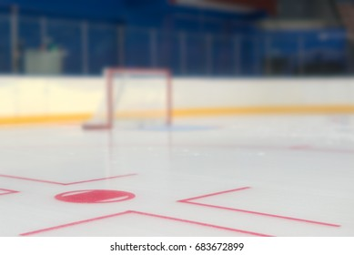 Face off spot in front of hockey goal.
