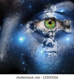 Face overlay of the seven sisters constellation with a Celtic cross centering around the green eye