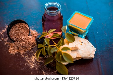 Face pack of devil's dung powder on wooden surface i.e. Hing powder well mixed with mulpani mitti or fuller's earth and rose water.Used for the treatment of Acne and pimples.