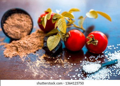 Face pack of hing or Asafoetida on wooden surface i.e. Hing powder well mixed with tomato pulp and sugar.For the treatment of skin whitening,.All the ingredients present on the surface.