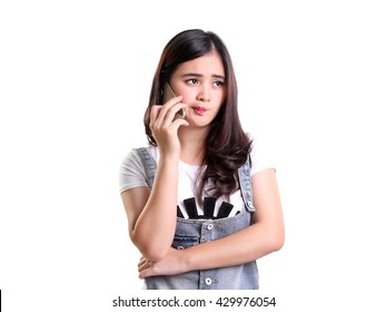 Face portrait of Asian girl expressing disappointment when doing phone call, isolated on white background