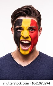 Face portrait of happy fan support Belgium national team with painted face isolated on white