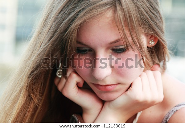 face portrait of sad young girl