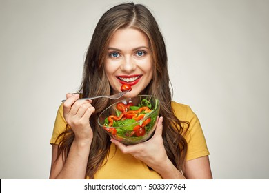 face portrait of young happy woman eating salad. healthy lifestyle with green food.
