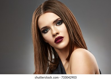 Face portrait of young woman with smoky eyes make up. isolated.