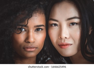 Face portraits with women of different ethnicities. Concept about woman , and human mankind