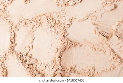 Face powder texture isolated on white background. Cosmetics texture. top view, flat lay