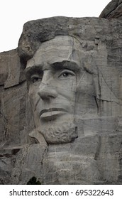 The face of  President Abraham Lincoln carved into the granite of Mount Rushmore National Memorial in South Dakota.