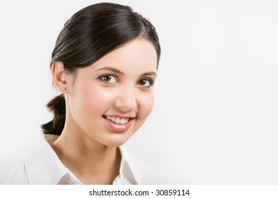 Face of pretty girl looking at camera over white background
