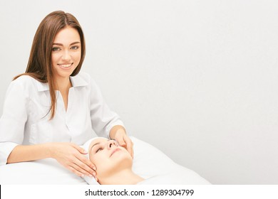 Face professional massage. Spa skincare treatment. Health facial masseur. Girl with doctor hands. Relax cosmetology procedure.