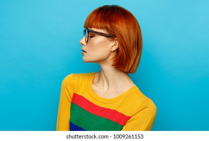 Face profile of young woman with glasses and red hair