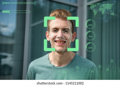 Face recognition. Biometric verification. The concept of a new technology for face recognition on a polygonal mesh. A young guy with a polygonal mesh on his face.