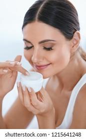 Face Skin Care. Beautiful Woman With Facial Cream. Cosmetics