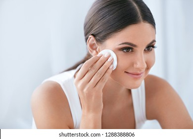 Face Skin Care. Beautiful Woman Removing Makeup With Cotton Pad