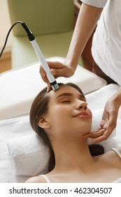 Face Skin Care. Closeup Of Beautiful Woman Getting Oxygen Jet Peeling, Microdermabrasion Treatment At Beauty Salon. Girl Enjoying Skin Cleansing Procedure At Cosmetology Center. High Resolution Image