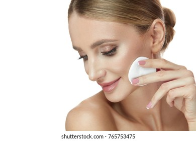 Face Skin Care. Closeup Of Beautiful Happy Young Woman Cleaning Facial Skin With White Cosmetic Cotton Pad. Portrait Of Beautiful Smiling Female Model Removing Makeup Using Cleanser. High Resolution