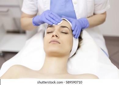 Face Skin Care. Woman in beauty salon