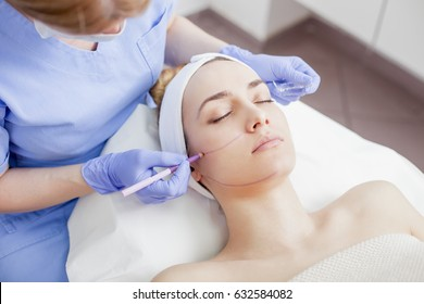 Face skin care. Woman getting facial treatment