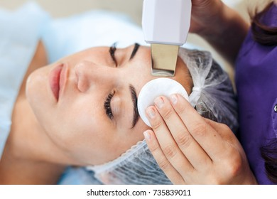 Face skin care. Woman getting facial ultrasound cleaning at beauty salon