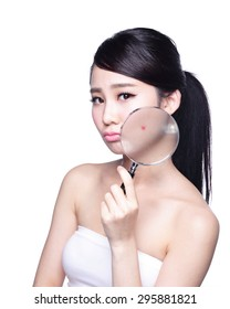 Face Skin Problem - young woman with a acne and magnifying glass check it isolated, concept for skin care, asian