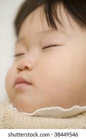Face of a sleeping baby girl.
