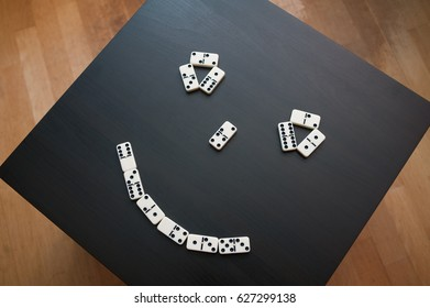 face with smile made from dominoes