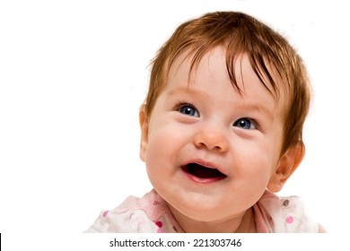 Face smiling baby with blue eyes and dark hair disheveled closeup surprised face isolated on white background