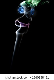 Face in smoke plume on a black background