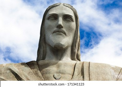 Face of the statue of Christ the redeemer in Rio de Janeiro against blue sky