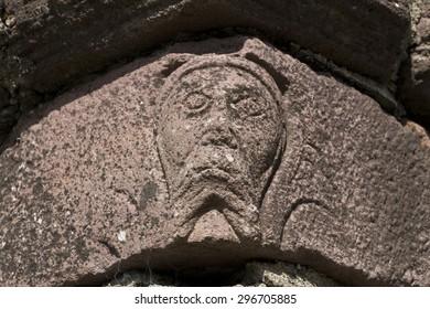 A face in the stone at Innisfallen Abbey on Innisfallen Island, Lough Leane, Killarney, County Kerry