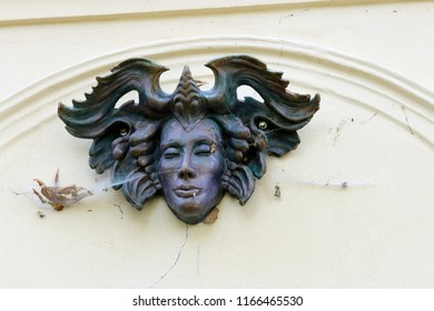 the face of the succubus on the wall
