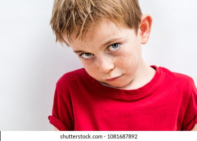 Face of a sulking little boy expressing upset apologies, adorable fragility, tenderness and sadness, white background