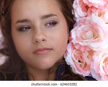face of teenage girl in pink rose flowers