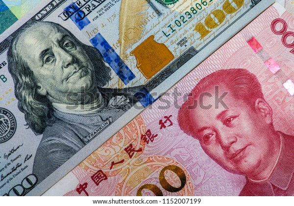 Face to face of US dollar banknote and China Yuan banknote for 2 biggest economic in the world which now United states of America and China have war trade.Both countries conflict increase tariff tax.