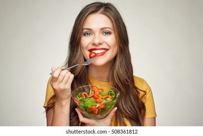 face woman close up portrait. girl eating salad on gray isolated background.