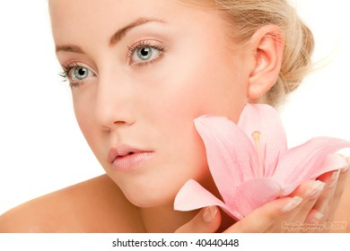 Face of woman with flower, white background
