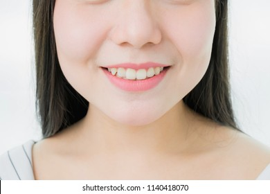 The face of a woman with good skin health are smiling and pink lips, for use in advertising beauty products.