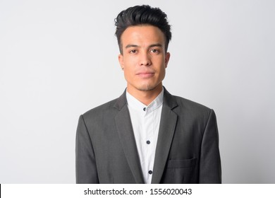 Face of young Asian businessman in suit